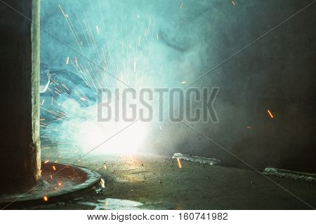 Metal Welding with sparks and smoke in industrial
