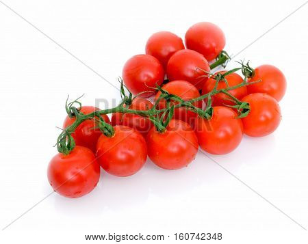 Ripe Fresh Cherry Tomatoes on Branch Isolated on White Background