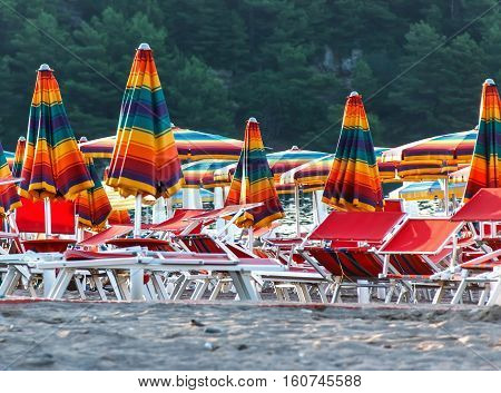 beach and beach umbrellas on a hot summer day rest on islands
