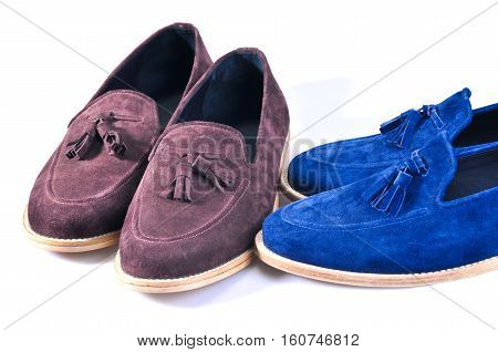 Men's leather loafers (moccasins) stylish blue and beige two pairs shoes isolated on white background. Handmade Shoes