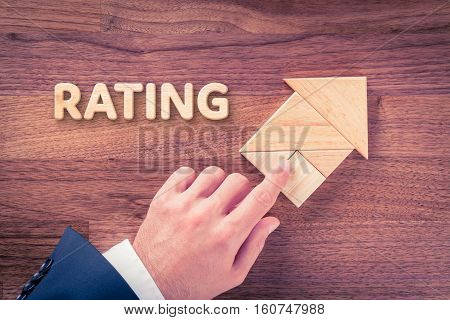 Increase rating concept. Businessman plan rating growth represented by arrow.