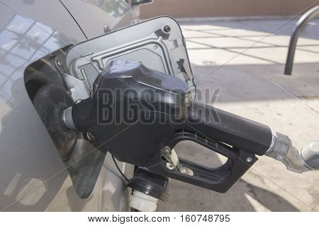 Fossil fuel pumping into a compact vehicle