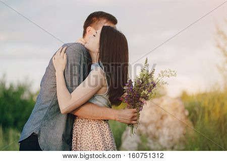 Loving couple walking on the field and sitting in cafes