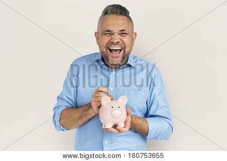 Man Smiling Happiness Piggy Bank Saving Portrait Concept