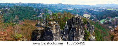 Panoramic view of Bastei. It is a rock formation towering 194 metres above the Elbe River in the Elbe Sandstone Mountains of Germany major landmark of the Saxon Switzerland National Park. Germany
