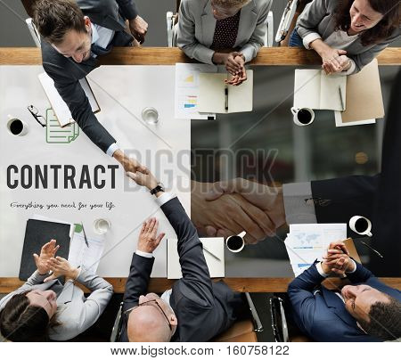 Contract word on business handshake background