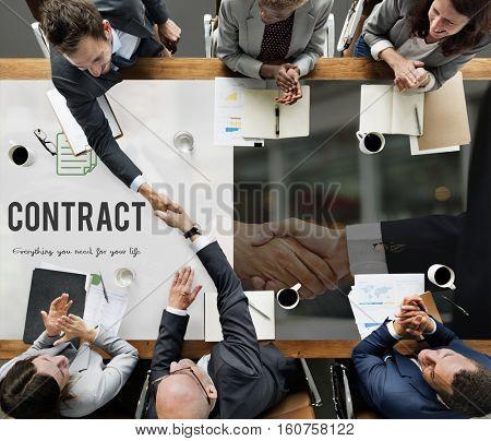 Contract word on business handshake background