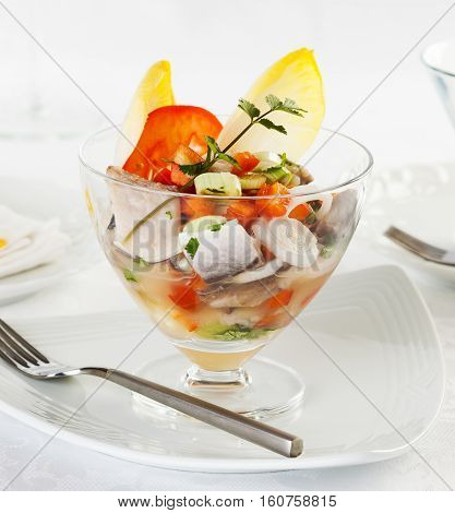 Fish ceviche typical dish from Peru served in a glass
