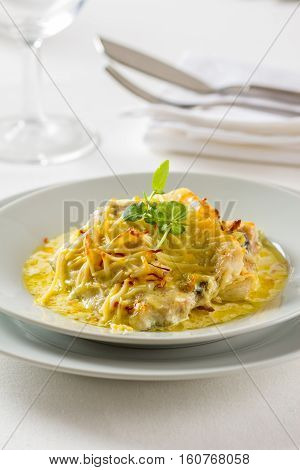A beautiful dish of sea bass fillet covered with a saffron sauce
