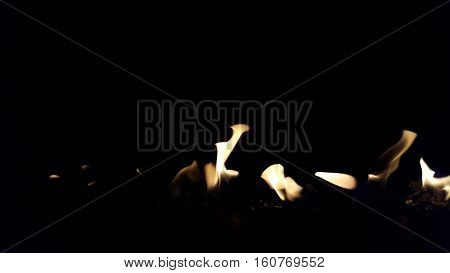 Orange flames of fire against a black background
