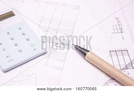 drawing calculation of business investment project on white papers