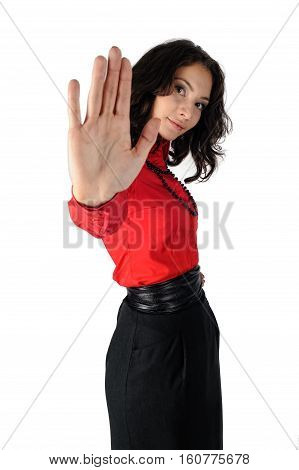 Serious young woman showing stop gesture. Isolated over white background