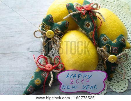 Textile hearts handmade and lemon on the table. happy new year