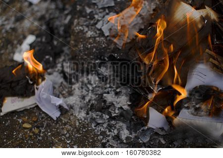 burning paper letters closeup. envelopes and letters on fire