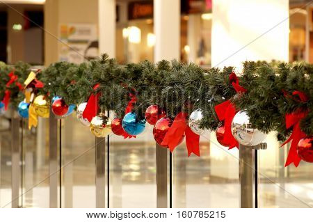Christmas decoration of shopping center spheres bows and branches of a fir-tree