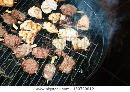 Pieces of meat preparing on the grill in restaurant