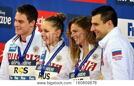 Hong Kong, China - Oct 29, 2016. Winner russian team (DONETC Stanislav, EFIMOVA Yuliya, MOROZOV Vladimir, USTINOVA Daria) at the Victory Ceremony of  Mixed 4x50m Medley Relay. FINA Swimming World Cup.