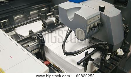 Machine working in printing house, polygraph industry - cleaning equipment, front view, close up
