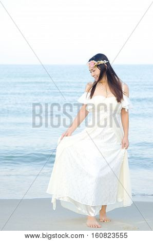 Outdoor Bride on the beach in the evening