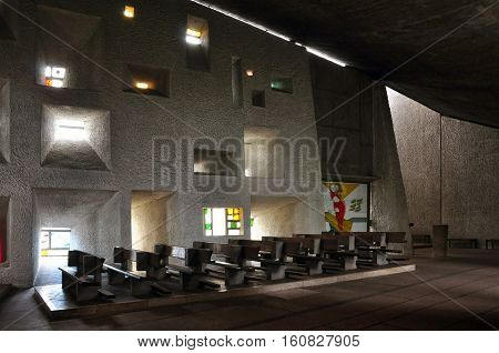 RONCHAMP, FRANCE - APRIL 23, 2016: Pilgrimage Church of Notre Dame du Haut in Ronchamp. The architect is Le Corbusier. Interior of the church. Franche-Comte, France.