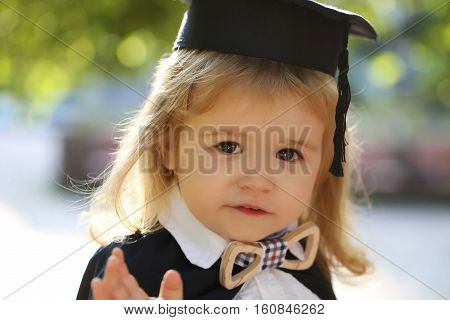 Little Boy Child In Mantle Outdoor
