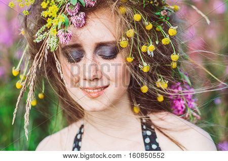 Portrait Of Young Girl With Closed Eyes In Willow-herb Field