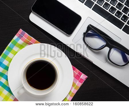 Business concept cafe. Laptop smart phone glasses down for coffee break