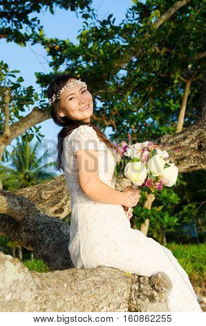 Outdoor Bride on the beach with sunset in the evening.