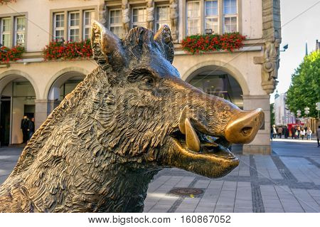 Munich, Germany - October 16, 2011: Statue bronze boar. It is located directly opposite the German Museum of hunting and fishing, which once housed the Church of St. Augustine.