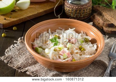 Salad With Sauerkraut, Ham, Apple And Green Peas. Snack On A Festive Table.