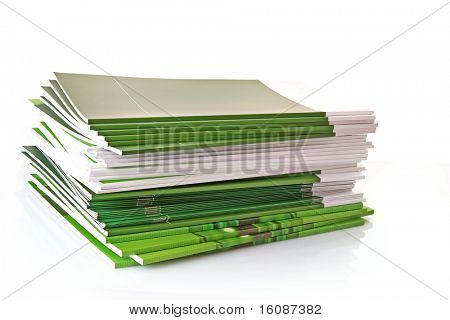 Pile of color magazines isolated on white background