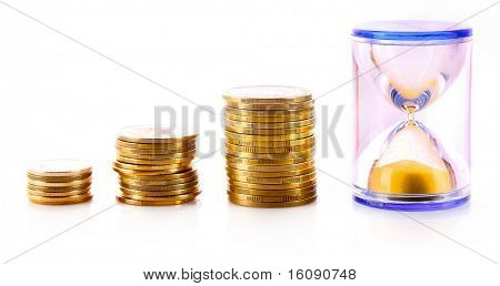 Coins and sand clock isolated on white