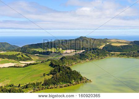 Aerial view on Lagoa das Furnas countryside on Sao Miguel Island Portugal. Summer countryside landscape of Azores archipelago.