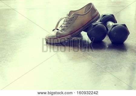 sport shoe and metal dumbbell fitness sport equipment of care healthy