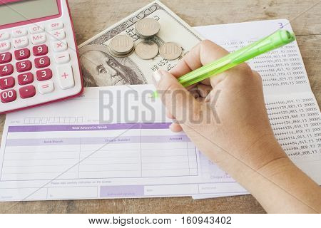 passbook bank with hand writing bill deposit