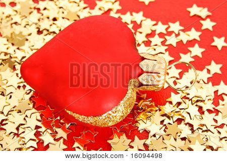 Golden stars in the form of confetti  and  christmas toys