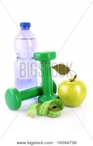 Dumbbells, green apple, measuring tape and a bottle of water isolated on white