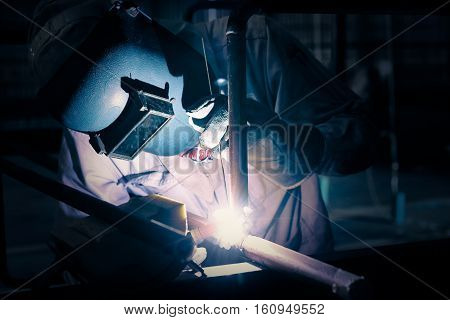 Welding steel pipe with Mig-Mag method for industrial work. Gas metal arc welding.add retro filter.