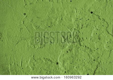 Stucco green wall background or texture.Plaster, plaster texture, plaster background. Green wall, green background. Concrete, concrete background.