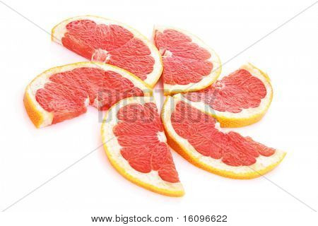 Slices of grapefruit in the form of circle isolated on white