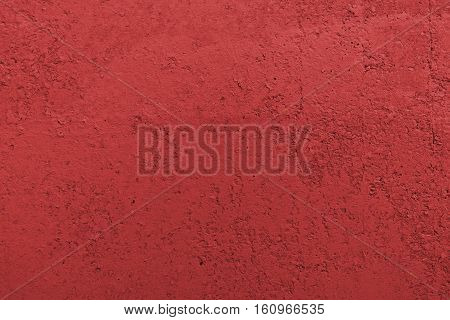 Stucco red wall background or texture.Plaster, plaster texture, plaster background. Red wall, red background. Color plaster.