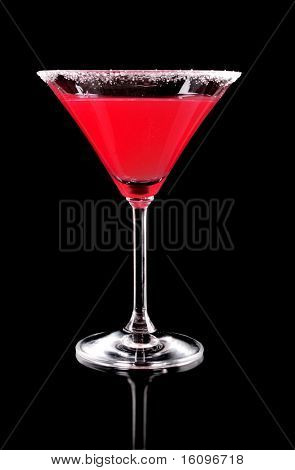Martini glass with red coctail on black background