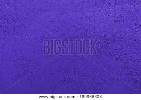 Stucco ultraviolet wall background or texture.Plaster, plaster texture, plaster background. Ultraviolet wall, ultraviolet background.Color plaster. Concrete, concrete background.