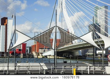 post card view to background of Rotterdam city harbour, future architecture concept, skyscraper lifestyle cocept casual close up