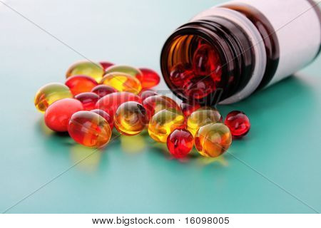 red capsules of vitamins on a blue background