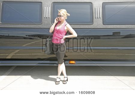 Angel Standing Near Stretch Limo