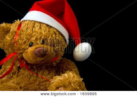 Christmas Teddy Bear Close Up On Black Background
