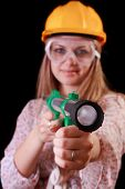 Young woman in helmet with toy bazooka