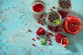 Постер, плакат: Pomegranate Mint And Garnet Juice On A Blue Background Concrete The Concept Of Healthy Nutrition A
