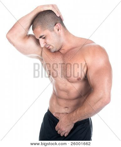 Athletic sexy attractive male body builder, demonstrating contest pose. Studio shot, black white ground.